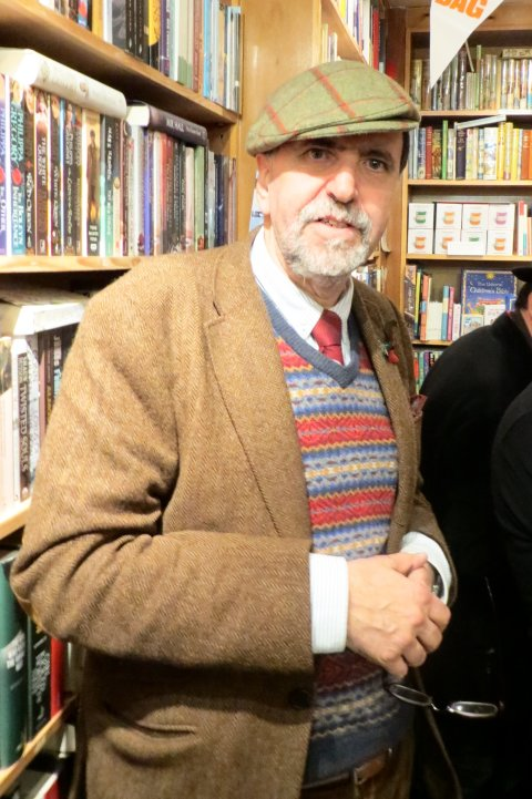 Richard Knowles, of Rickaro Books, looking for the 102nd use of a flat cap...
