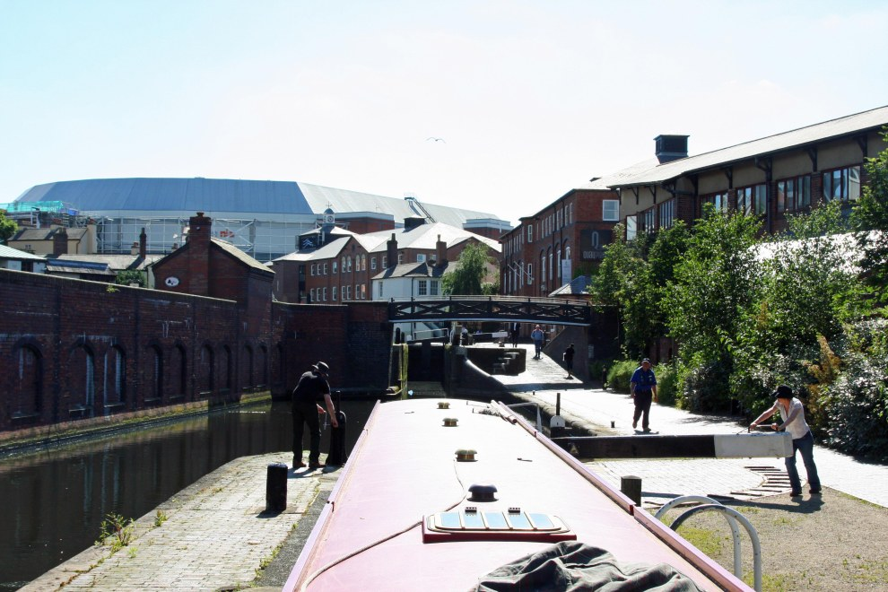 Michael returns from opening Lock 1, whilst I open lock 2.  Rising above us, the National Indoor Arena.